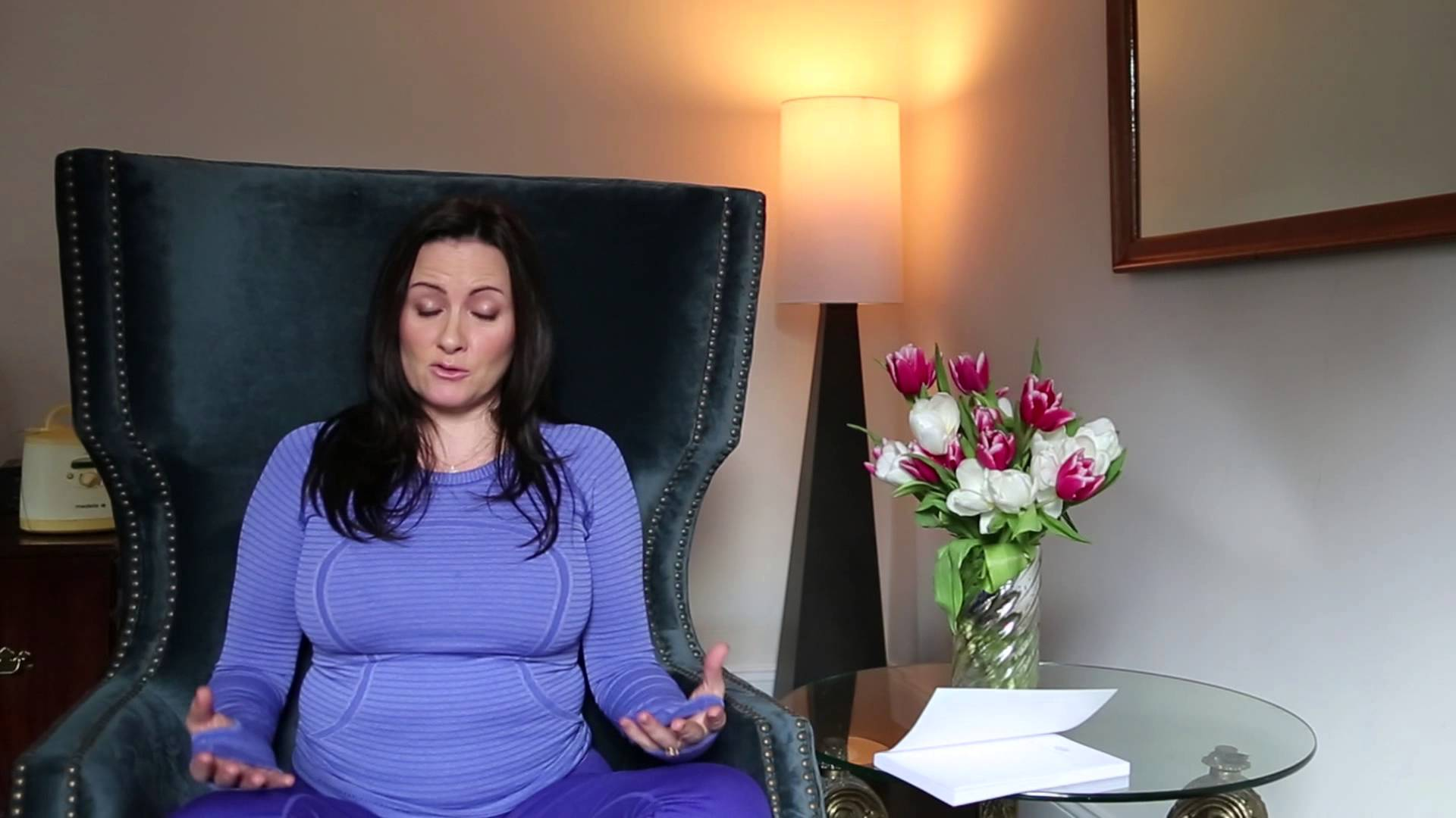 Image of Aimee Raupp Meditating on a chair