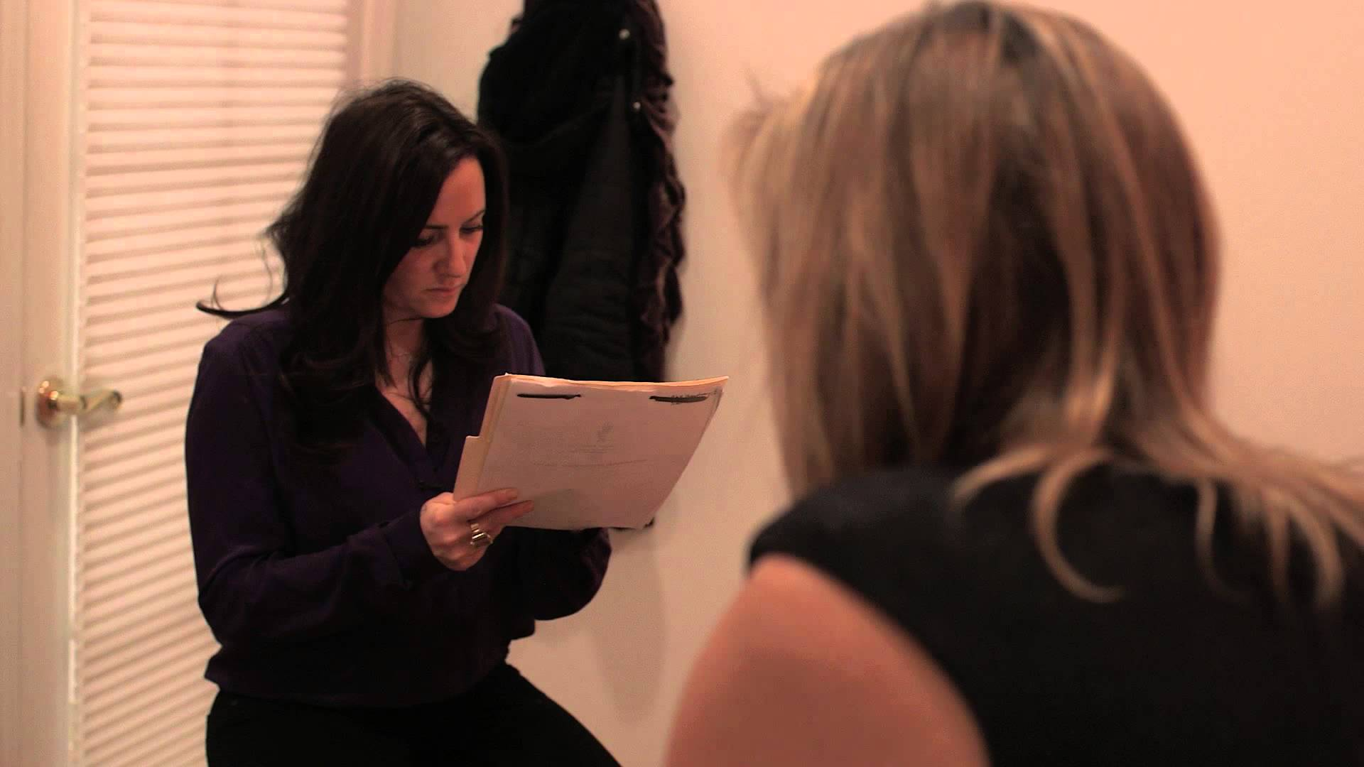 Image of Aimee Raupp Speaking to a client