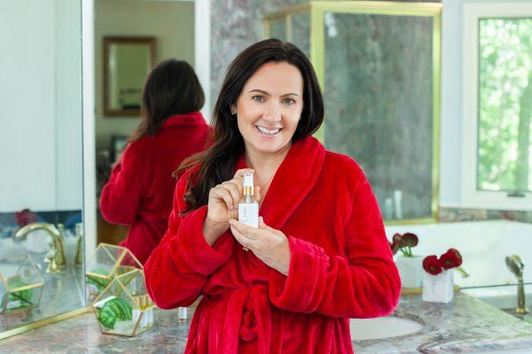 Image of Aimee Raupp Holding Nourishing Facial Oil