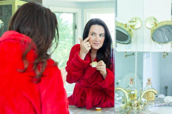 Aimee Raupp Putting ARB Eye Cream On