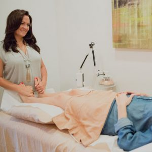 Image of Aimee Raupp Doing Acupuncture on Client