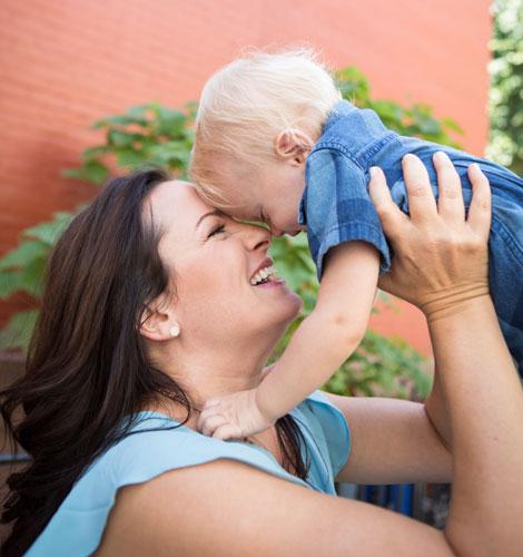 Aimee Raupp holding toddler