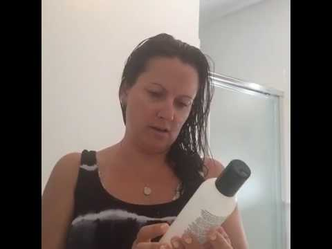 Image of Aimee Raupp Looking at Ingredients on a bottle