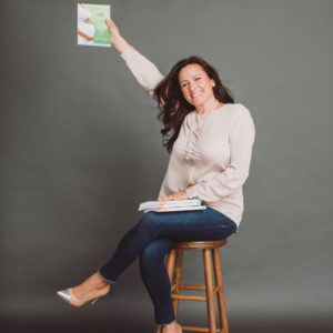Image of Aimee Raupp Holding Her Book Yes You Can Get Pregnant