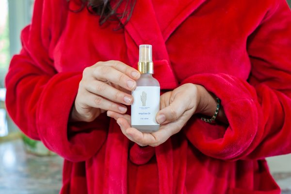 Image of Aimee Raupp Holding Mag-Ease Oil