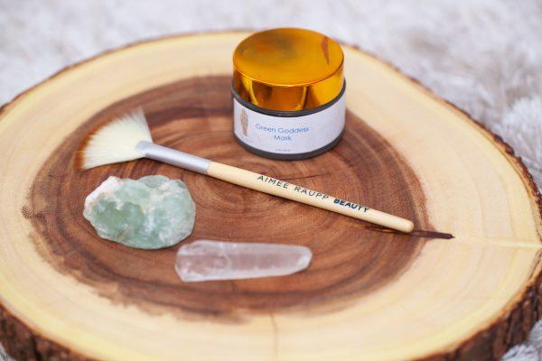 Image of Aimee Raupp Organic Green Goddess Mask, Facial Brush, and crystals