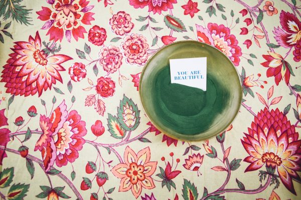 """Image of bowl with paper that says """"You are Beautiful"""""""