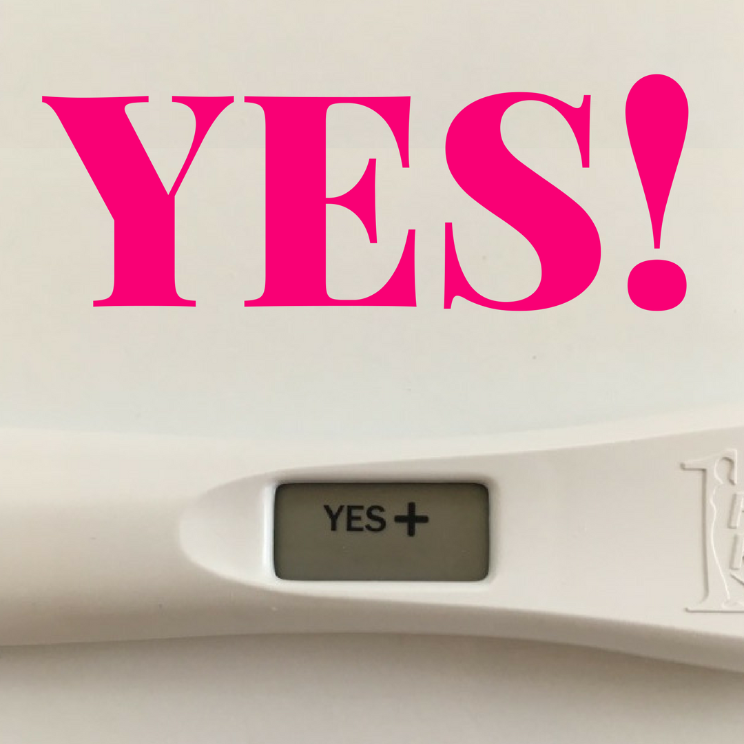 Positive pregnancy test with the text: Yes!