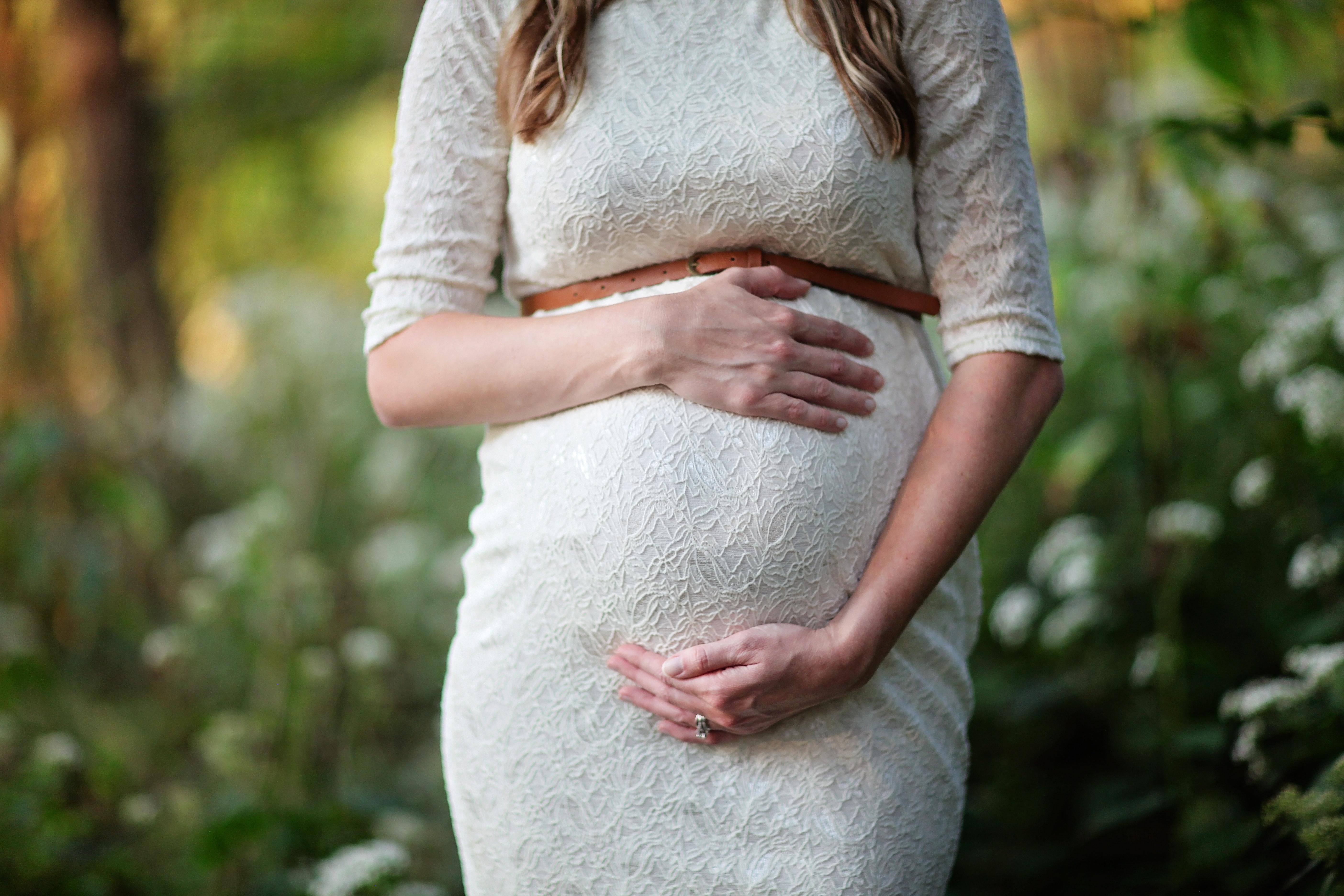 Image of Pregnant Woman Holding Belly