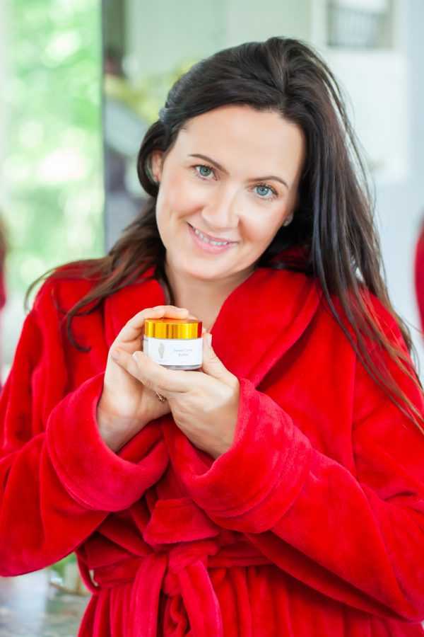 Image of Aimee Raupp Holding Organic Sweet Love Butter