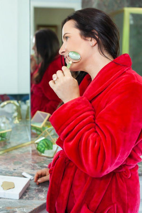 Image of Aimee Raupp Using Jade Roller