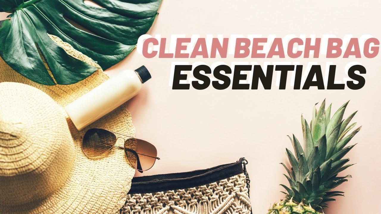 Image of a beach bag, sunglasses, sun hat, pineapple